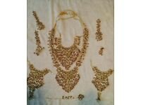 Traditional Indian jewellery set with necklace headgear hand bracelet