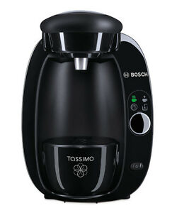 Tassimo coffee brewer with pods and milk