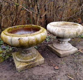 Pair of matching weathered stone garden urn planters