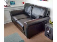 as new black leather sofa / settee