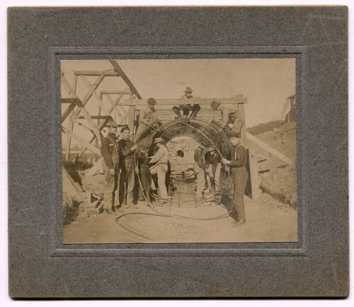 c1903 Mounted Photo of Workers w Coiled Steel Cable to Create a Concrete Tunnel