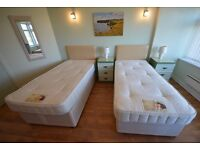 Pair of single 2 drawer divan beds, with headboards, mattresses and protectors