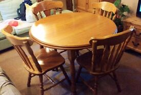 Wooden extendable dinner table and six chairs