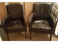 2 well worn brown leather tub chairs