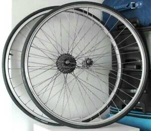 TWO 700 BICYCLE WHEELS. 7 COG CASSETTE. 23c - 25c TYRES.