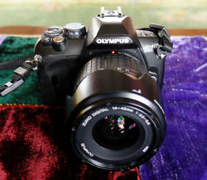 Olympus E410 with 2 lens. 14-45mm and 40-150mm