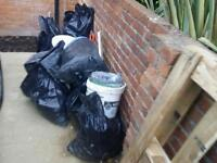 Stone windowsill, lentil, toilet, rain cover and bags with soil