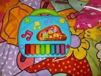 Piano/keyboard toy playmat and rattle