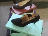 2 pairs of black shoes