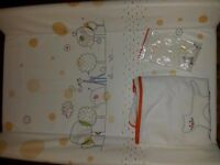 Baby changing mat padded with hard base. Fits cot bed.