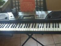 Yamaha keyboard with stand and booklet and charger