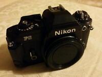 Nikon FG 35mm film SLR camera body.