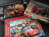 Ravensburger jigsaws. 2 x Disney Cars, 1 x Disney Planes.