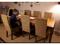 Beautiful dining table with 6 rattan chairs