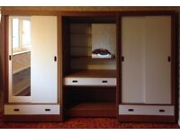 Set of well made wardrobes with storage above