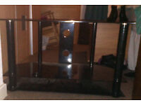 Glass TV Stand in perfect condition, no scratches or chips.