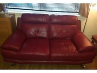 Real leather red suite. 2 seater sofa 2 chairs 1 footstool. RRP £1600 from Reids offers welcome