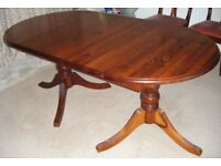 Solid Pine extending dining room table and 4 matching chairs. Ducal manufacturer.