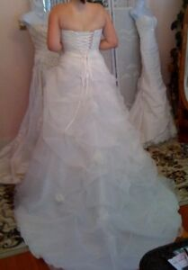 WEDDING DRESS (BRAND NEW).  FUNDS TO GO TO CHARITY