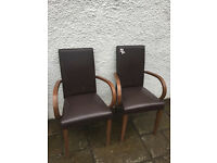 2 x Carver style chairs with arms , in brown faux leather . .
