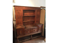 Oak Sideboard/Dresser , lovely carved detail and condition. Has cupboards that lock with key .