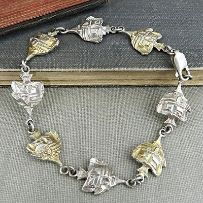 - Two-Tone Sterling Silver Angel Fish Link Bracelet