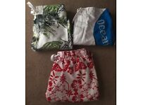 3 pairs of men's swim style shorts, small