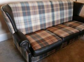 Beautiful high back tartan and leather chesterfield style sofa.