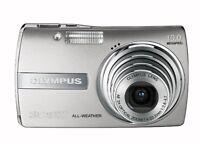 Olympus Stylus 1000 10MP Digital Camera with Digital Image Stabilized 3x Optical