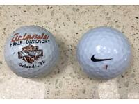 PAIR OF GOLF BALLS (used)
