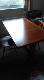 Dark wood, 6 place dining table with extending leaf, so could seat 8. Pedestal base and 6 chairs.