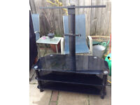 Black smoked glass television table