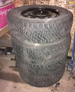 235/65 R17 studded winter tires on rims