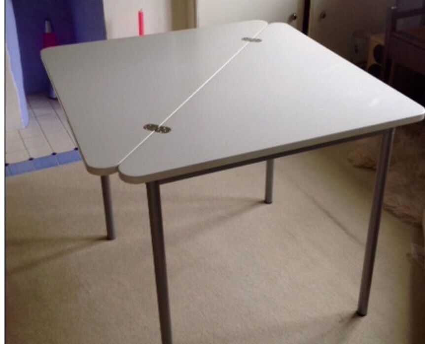"""TableIKEAin Greenford, LondonGumtree - Excellent condition white Ikea Lokka style table solid with metal legs and solid top. Folds in half diagonally, so you can use as a triangular table too. 78cm x 78cm (approx 31""""), 69cm height. Dismantles or folds down. Weighs about 10 kg. to be..."""