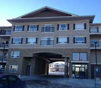 WEST END, TOP FLOOR, 2 BDRM + DEN, WEST FACING, HEATED PARKING.