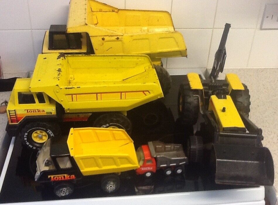 Job lot of Tonka trucks.