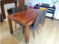 Next Dakota solid mango wood dining table