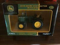 A JOHN DEERE 4020 TRACTOR WITH AFWD 1.32 BY BRITAINS BOXED 2008