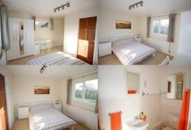 A sunny double room with an en-suite. In a spacious detached house five minutes from train station.