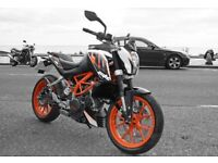 KTM 390 Duke, bought brand new in May 2014, only used once, yes 54 miles from new.