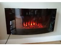 Electric wall-mounted fire with remote control, good condition.
