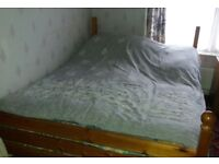 Pine wood double bed with matress.
