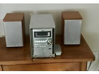 Stereo CD Player and Radio with Speakers.