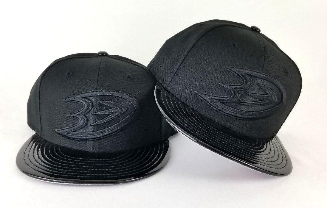 42bf11ff0de7 ... best new era anaheim ducks black patent leather snapback hat for jordan  11 cap gown 0527c