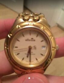 Men's gold ellesse watch