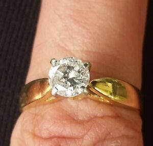 14 k .72 solitaire diamond ring with stamped claws