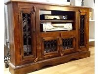 Beautiful solid wood corner TV/media cabinet with inset decoration. As new condition.