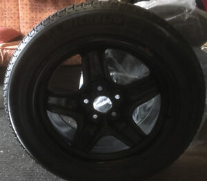 4 like new Michelin x-ice winter tires and rims