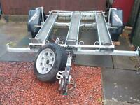 Trailer factory built for 3 motorbikes or quad