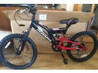 Muddyfox mountain bike 20 inch wheel. Brand New. Too big for our son. Never ridden